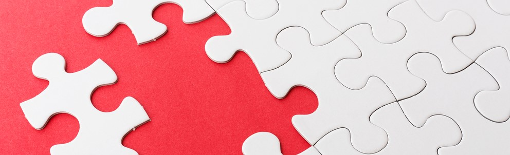 Cropped Incomplete puzzle with missing piece over red background